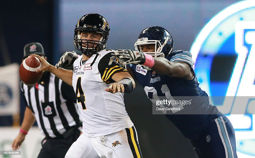 <a gi-track='captionPersonalityLinkClicked' href=/galleries/search?phrase=Zach+Collaros&family=editorial&specificpeople=6237743 ng-click='$event.stopPropagation()'>Zach Collaros</a> #4 of the Hamilton Tiger-Cats is sacked by Matt Coates #81 of the Hamilton Tiger-Cats during their game at Rogers Centre on October 25, 2014 in Toronto, Canada.