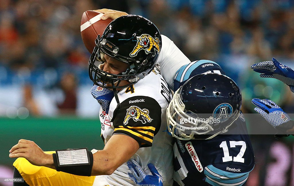 <a gi-track='captionPersonalityLinkClicked' href=/galleries/search?phrase=Zach+Collaros&family=editorial&specificpeople=6237743 ng-click='$event.stopPropagation()'>Zach Collaros</a> #4 of the Hamilton Tiger-Cats is sacked by Matthew Ware #17 of the Toronto Argonauts during their game at Rogers Centre on October 10, 2014 in Toronto, Canada.
