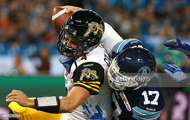 Zach Collaros of the Hamilton TigerCats is sacked by Matthew Ware of the Toronto Argonauts during their game at Rogers Centre on October 10 2014 in...