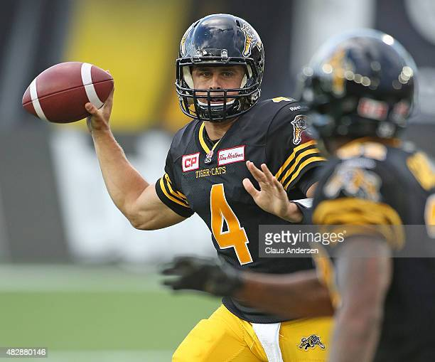 Zach Collaros of the Hamilton TigerCats looks to pass against the Toronto Argonauts during a CFL football game at Tim Hortons Field on August 3 2015...