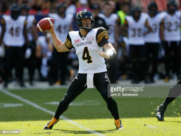 Zach Collaros of the Hamilton TigerCats looks to pass against the Toronto Argonauts during a CFL game at BMO Field on June 25 2017 in Toronto Ontario...