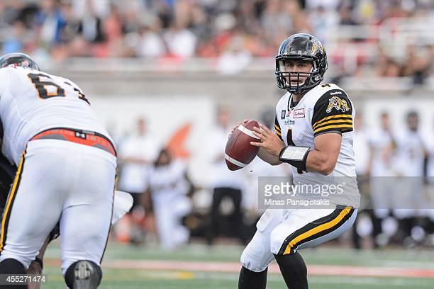 Zach Collaros of the Hamilton TigerCats looks to pass the ball during the CFL game at Percival Molson Stadium on September 7 2014 in Montreal Quebec...