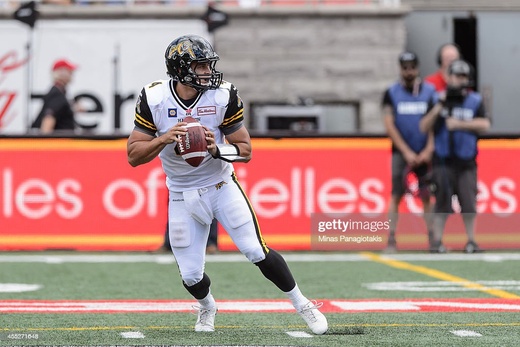 <a gi-track='captionPersonalityLinkClicked' href=/galleries/search?phrase=Zach+Collaros&family=editorial&specificpeople=6237743 ng-click='$event.stopPropagation()'>Zach Collaros</a> #4 of the Hamilton Tiger-Cats looks to pass the ball during the CFL game against the Montreal Alouettes at Percival Molson Stadium on September 7, 2014 in Montreal, Quebec, Canada. The Alouettes defeated the Tiger-Cats 38-31.