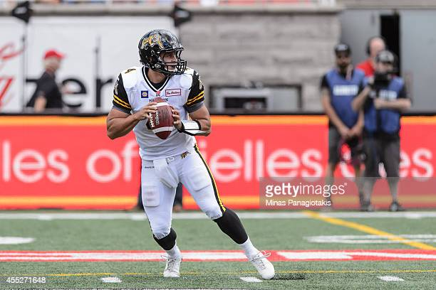 Zach Collaros of the Hamilton TigerCats looks to pass the ball during the CFL game against the Montreal Alouettes at Percival Molson Stadium on...
