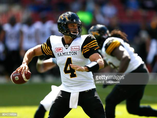 Zach Collaros of the Hamilton TigerCats looks to pass the ball against the Toronto Argonauts during a CFL game at BMO Field on June 25 2017 in...