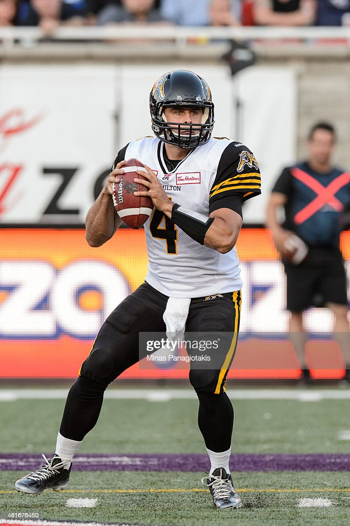 <a gi-track='captionPersonalityLinkClicked' href=/galleries/search?phrase=Zach+Collaros&family=editorial&specificpeople=6237743 ng-click='$event.stopPropagation()'>Zach Collaros</a> #4 of the Hamilton Tiger-Cats looks to play the ball during the CFL game against the Montreal Alouettes at Percival Molson Stadium on July 16, 2015 in Montreal, Quebec, Canada. The Montreal Alouettes defeated the Hamilton Tiger-Cats 17-13.