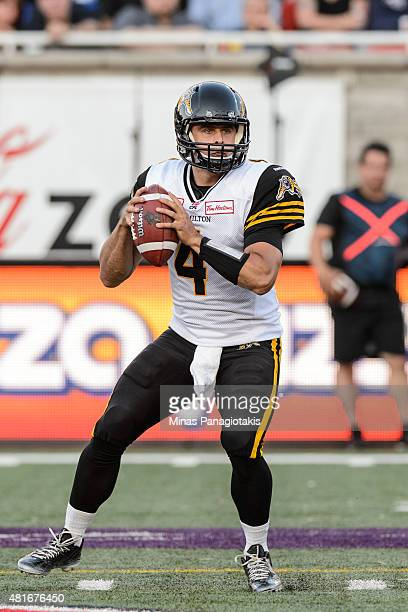 Zach Collaros of the Hamilton TigerCats looks to play the ball during the CFL game against the Montreal Alouettes at Percival Molson Stadium on July...