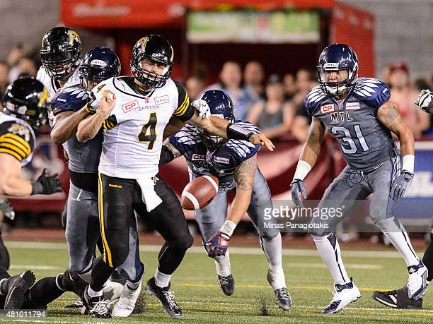 Zach Collaros of the Hamilton TigerCats looses the ball during the CFL game against the Montreal Alouettes at Percival Molson Stadium on July 16 2015...