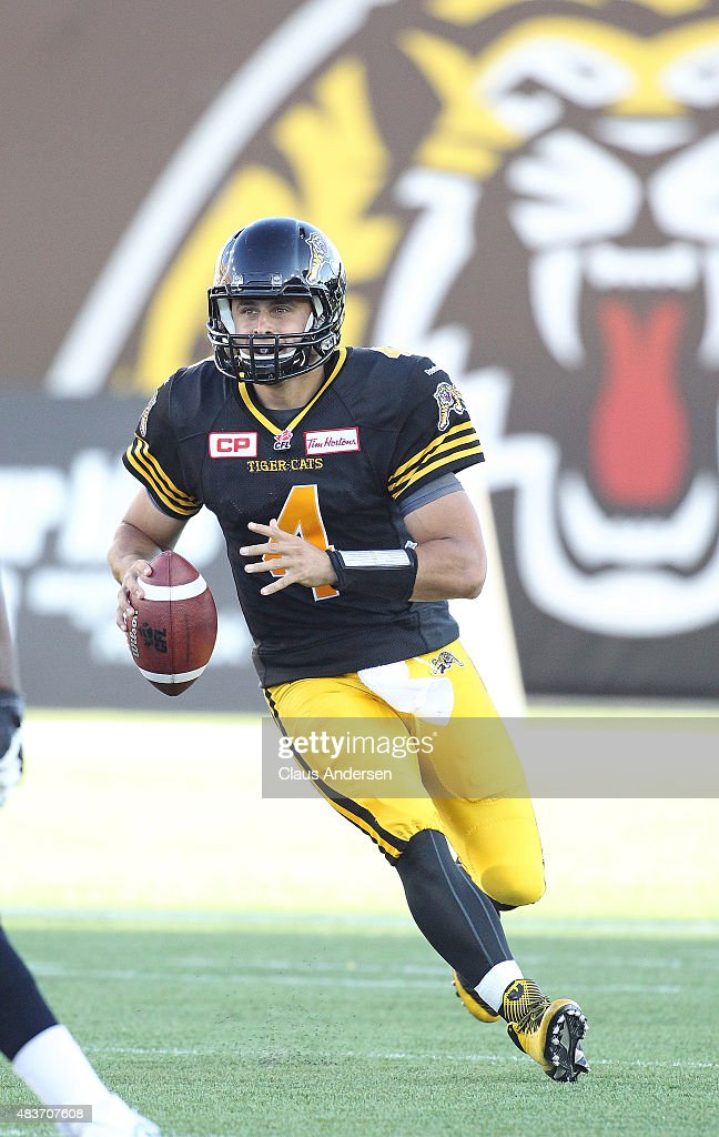 <a gi-track='captionPersonalityLinkClicked' href=/galleries/search?phrase=Zach+Collaros&family=editorial&specificpeople=6237743 ng-click='$event.stopPropagation()'>Zach Collaros</a> #4 of the Hamilton Tiger-Cats rolls out to make a pass against the Winnipeg Blue Bombers during a CFL football game at Tim Hortons Field on August 9, 2015 in Hamilton, Ontario, Canada. The Tiger-Cats defeated the Blue Bombers 38-8.