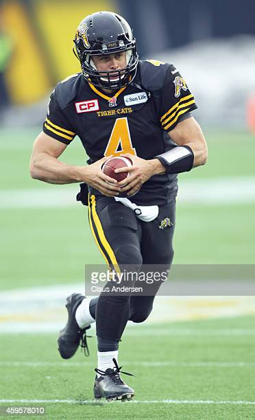 Zach Collaros of the Hamilton TigerCats runs with the ball against the Montreal Alouettes during the CFL football Eastern Conference Final at Tim...