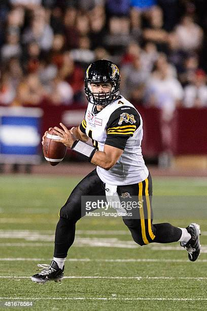 Zach Collaros of the Hamilton TigerCats runs with the ball during the CFL game against the Montreal Alouettes at Percival Molson Stadium on July 16...