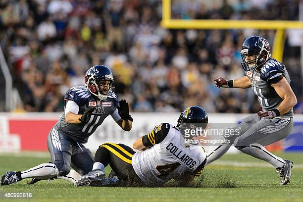 Zach Collaros of the Hamilton TigerCats slides in front of Chip Cox of the Montreal Alouettes during the CFL game at Percival Molson Stadium on July...