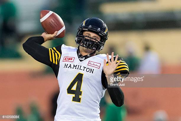 Zach Collaros of the Hamilton TigerCats throws a pass in pregame warmup for the game between the Hamilton TigerCats and Saskatchewan Roughriders at...