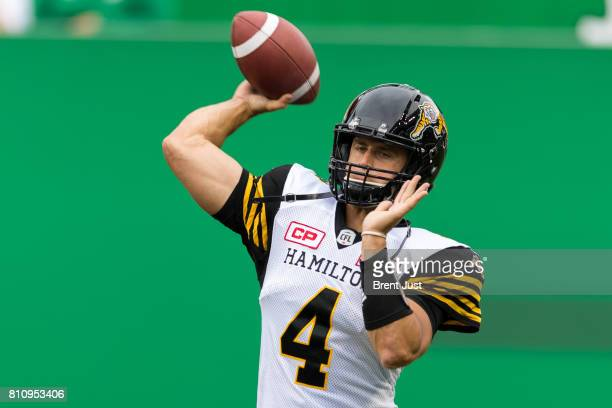 Zach Collaros of the Hamilton TigerCats throws a pass in pregame warmup for the game between the Hamilton Tiger Cats and the Saskatchewan Roughriders...