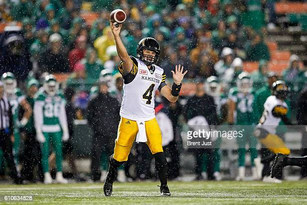Zach Collaros of the Hamilton TigerCats throws a pass in the rain during the game between the Hamilton TigerCats and Saskatchewan Roughriders at...