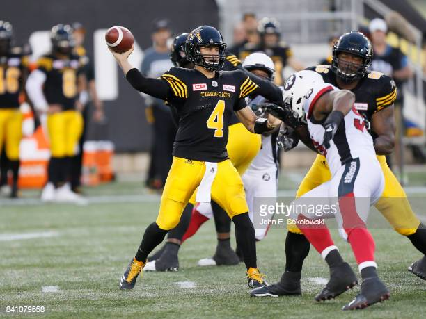 Zach Collaros of the Hamilton TigerCats throws under pressure from the Ottawa Redblacks during a CFL game at Tim Hortons Field on August 18 2017 in...