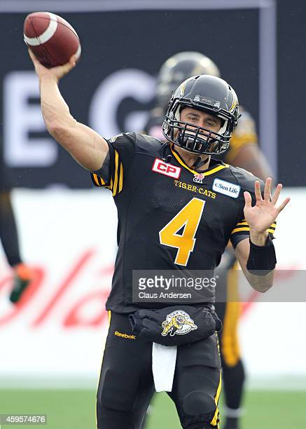 Zach Collaros of the Hamilton TigerCats warms up prior to play against the Montreal Alouettes in the CFL football Eastern Conference Final at Tim...