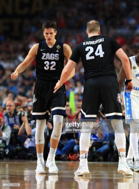 Zach Collins and Przemek Karnowski of the Gonzaga Bulldogs react in the second half against the North Carolina Tar Heels during the 2017 NCAA Men's...