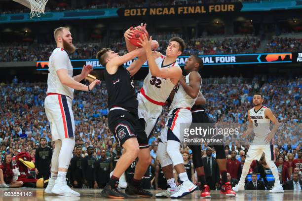 Zach Collins of the Gonzaga Bulldogs and Maik Kotsar of the South Carolina Gamecocks compete for a loose ball in the second half during the 2017 NCAA...