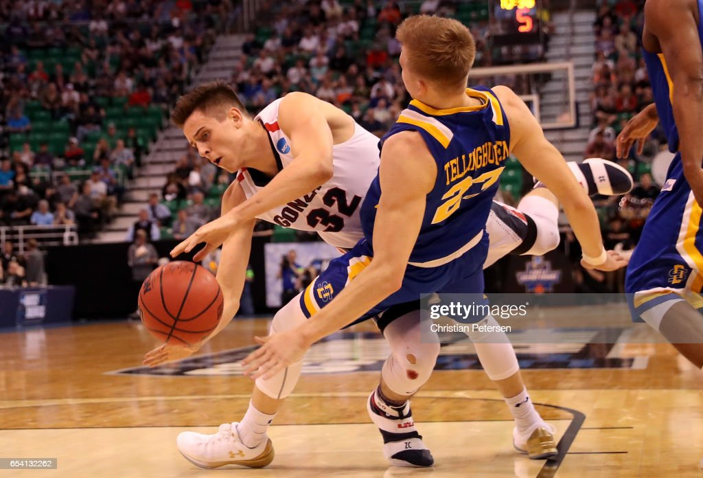 Zach Collins #32 of the Gonzaga Bulldogs collides with Reed Tellinghuisen #23 of the South Dakota State Jackrabbits in the first half during the first round of the 2017 NCAA Men's Basketball Tournament at Vivint Smart Home Arena on March 16, 2017 in Salt Lake City, Utah.