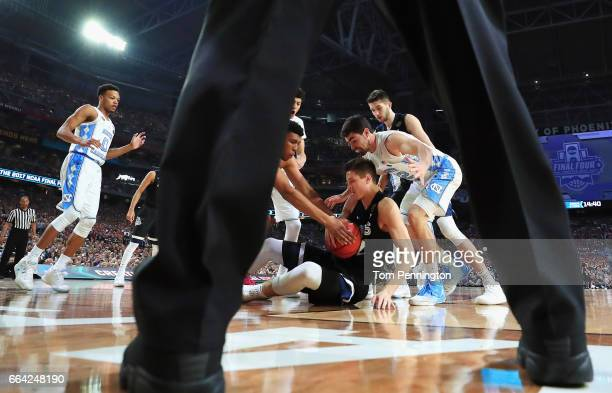 Zach Collins of the Gonzaga Bulldogs competes for a rebound with Luke Maye of the North Carolina Tar Heels in the first half during the 2017 NCAA...