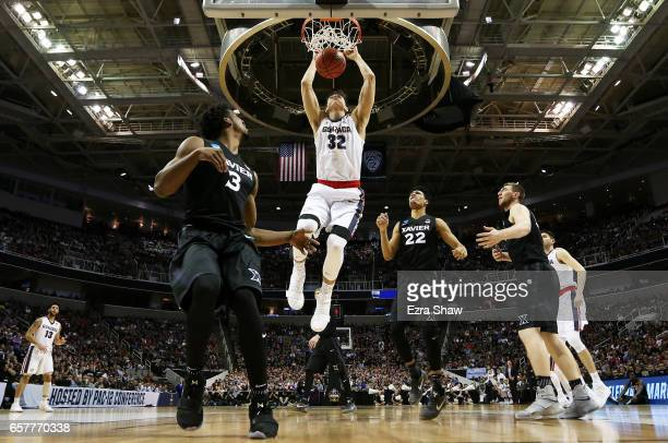 Zach Collins of the Gonzaga Bulldogs dunks against the Xavier Musketeers in the first half during the 2017 NCAA Men's Basketball Tournament West...