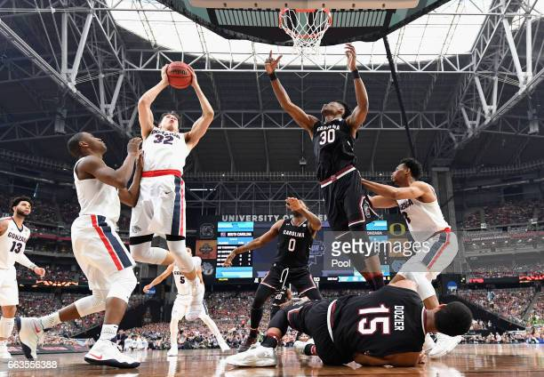 Zach Collins of the Gonzaga Bulldogs goes up with the ball against Chris Silva of the South Carolina Gamecocks in the second half during the 2017...