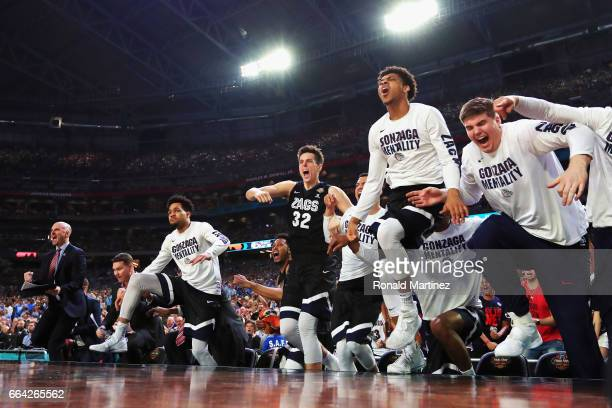 Zach Collins of the Gonzaga Bulldogs reacts with his team on the bench in the second half against the North Carolina Tar Heels during the 2017 NCAA...