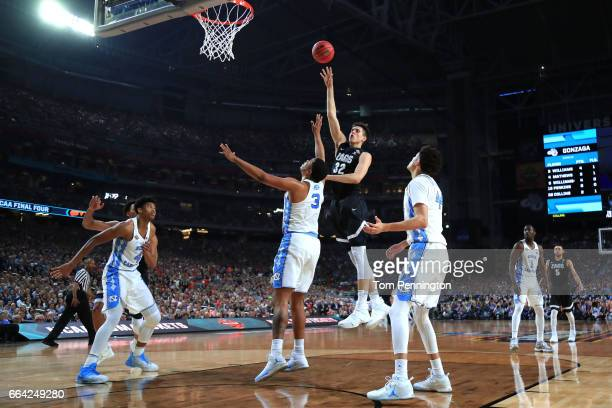 Zach Collins of the Gonzaga Bulldogs shoots against Kennedy Meeks of the North Carolina Tar Heels in the first half during the 2017 NCAA Men's Final...