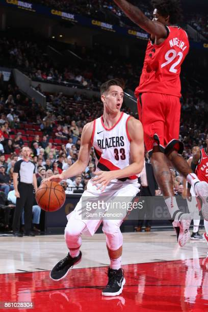 Zach Collins of the Portland Trail Blazers handles the ball during a pre season game against the Toronto Raptors on October 5 2017 at the Moda Center...