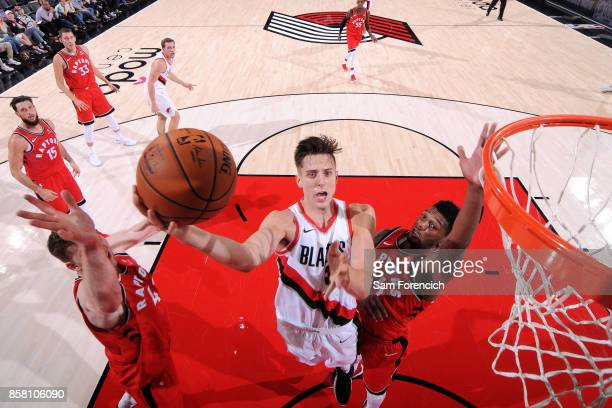 Zach Collins of the Portland Trail Blazers shoots a lay up during the game against the Toronto Raptors during a preseason game on October 5 2017 at...