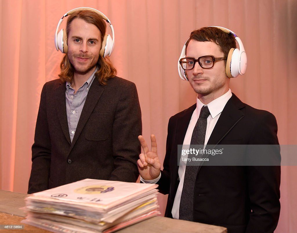 Zach Cowie and actor Elijah Wood both wearing Samsung Level headphones attend the Art of Elysium and Samsung Galaxy present Marina Abramovic's HEAVEN...