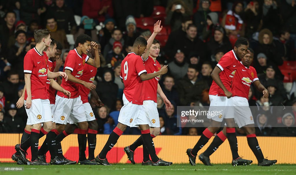 Zach Dearnley (C) of Manchester United U18s celebrates scoring their first goal during the FA Youth Cup Fourth Round match between Manchester United U18s and Hull City U18s at Old Trafford on January 13, 2015 in Manchester, England.