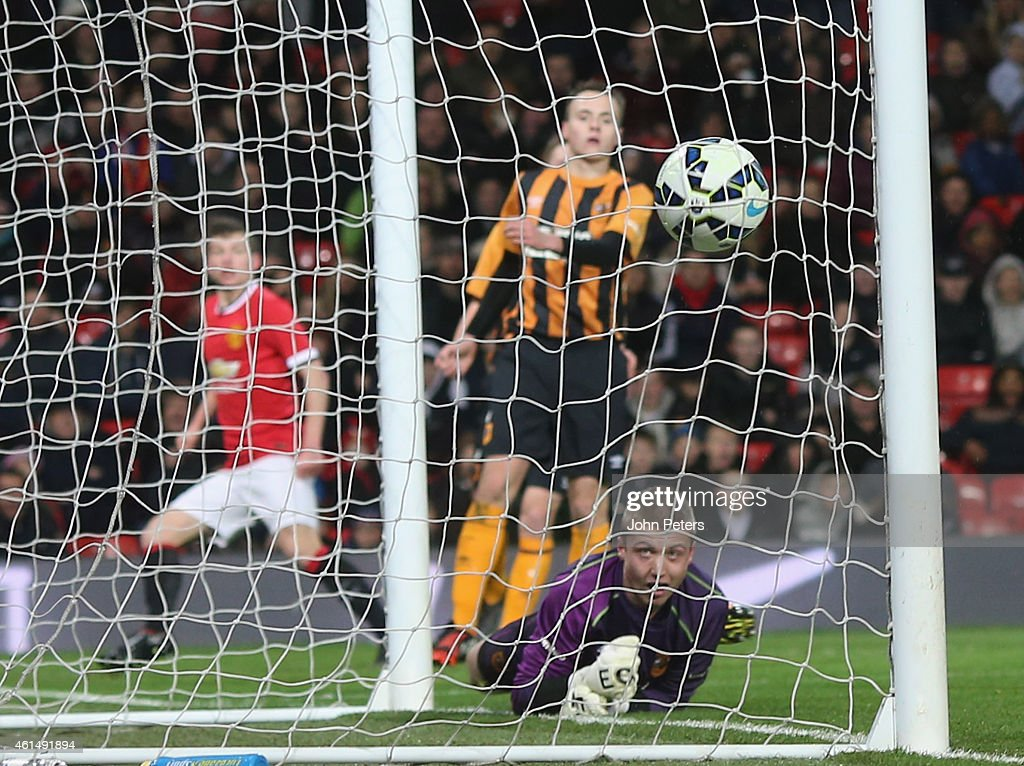 Zach Dearnley of Manchester United U18s scores their first goal during the FA Youth Cup Fourth Round match between Manchester United U18s and Hull City U18s at Old Trafford on January 13, 2015 in Manchester, England.