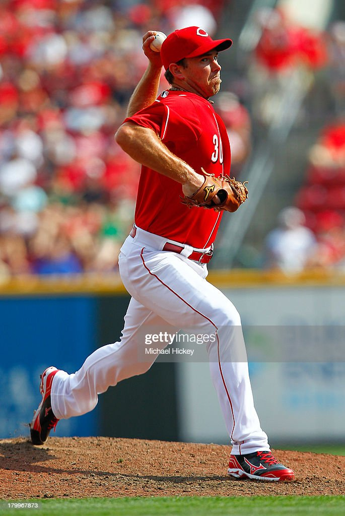 <a gi-track='captionPersonalityLinkClicked' href=/galleries/search?phrase=Zach+Duke&family=editorial&specificpeople=536571 ng-click='$event.stopPropagation()'>Zach Duke</a> #30 of the Cincinnati Reds pitches in relief in the eighth inning against the Los Angeles Dodgers at Great American Ball Park on September 7, 2013 in Cincinnati, Ohio. Cincinnati defeated Los Angeles 4-3.