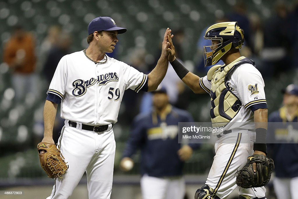 <a gi-track='captionPersonalityLinkClicked' href=/galleries/search?phrase=Zach+Duke&family=editorial&specificpeople=536571 ng-click='$event.stopPropagation()'>Zach Duke</a> #59 of the Milwaukee Brewers celebrates with Martin Maldonado #12 after a 8-3 win over the Arizona Diamondbacks at Miller Park on April 05, 2014 in Milwaukee, Wisconsin.