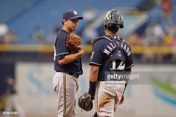 Zach Duke of the Milwaukee Brewers talks with Martin Maldonado of the Milwaukee Brewers during the game against the Tampa Bay Rays at Tropicana Field...