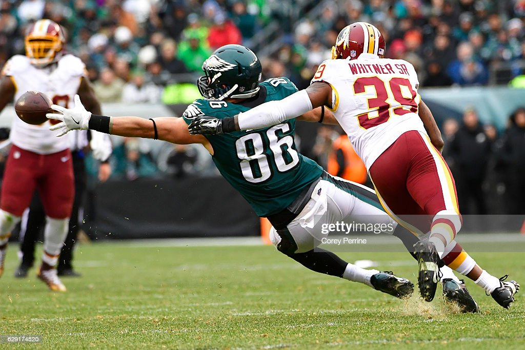Zach Ertz #86 of the Philadelphia Eagles can't make a reception as a pass it out of reach and Donte Whitner, Sr. #39 of the Washington Redskins pressures during the third quarter at Lincoln Financial Field on December 11, 2016 in Philadelphia, Pennsylvania. The Redskins won 27-22.