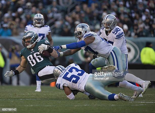 Zach Ertz of the Philadelphia Eagles catches a pass and is tackled by Mark Nzeocha and Damien Wilson of the Dallas Cowboys in the third quarter at...
