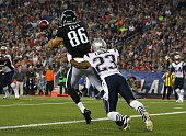 Zach Ertz of the Philadelphia Eagles catches a touchdown pass as Patrick Chung of the New England Patriots in the second quarter Gillette Stadium on...