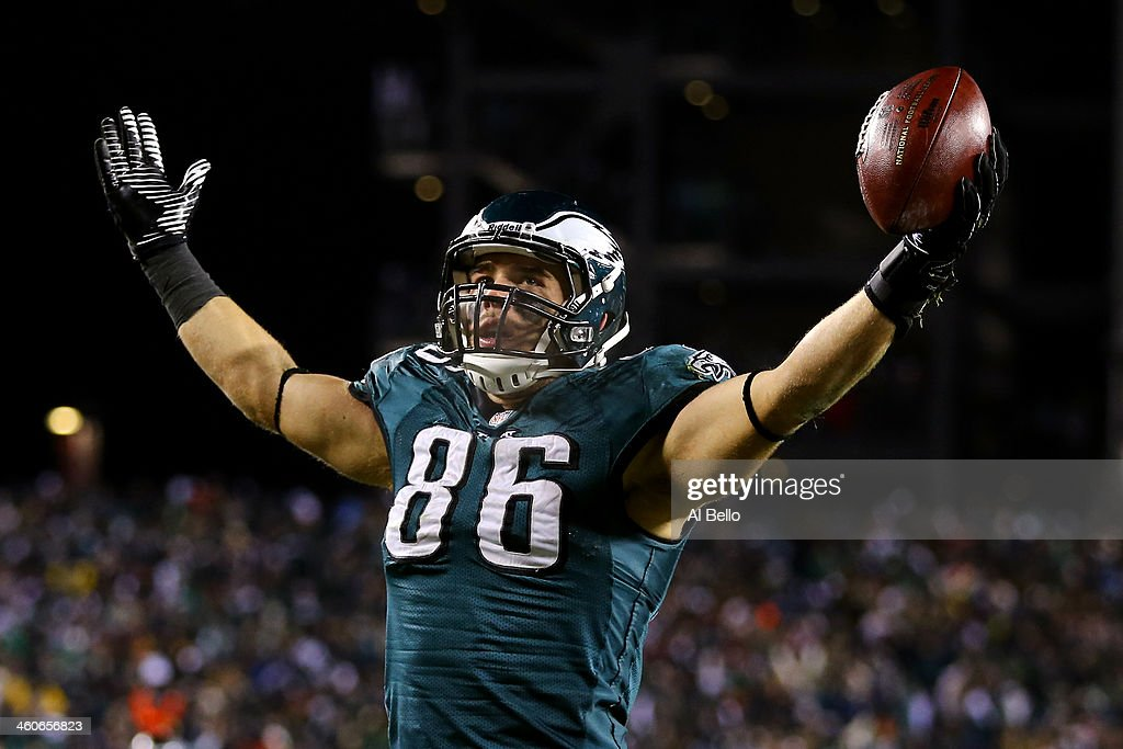 <a gi-track='captionPersonalityLinkClicked' href=/galleries/search?phrase=Zach+Ertz&family=editorial&specificpeople=7172878 ng-click='$event.stopPropagation()'>Zach Ertz</a> #86 of the Philadelphia Eagles celebrates after scoring a yard touchdown pass from Nick Foles #9 in the fourth quarter against the New Orleans Saints to take the lead 24-23 during their NFC Wild Card Playoff game at Lincoln Financial Field on January 4, 2014 in Philadelphia, Pennsylvania.
