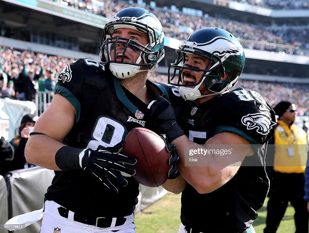 <a gi-track='captionPersonalityLinkClicked' href=/galleries/search?phrase=Zach+Ertz&family=editorial&specificpeople=7172878 ng-click='$event.stopPropagation()'>Zach Ertz</a> #86 of the Philadelphia Eagles celebrates his touchdown with teammate James Casey #85 in the first quarter against the Arizona Cardinals on December 1, 2013 at Lincoln Financial Field in Philadelphia, Pennslyvania.