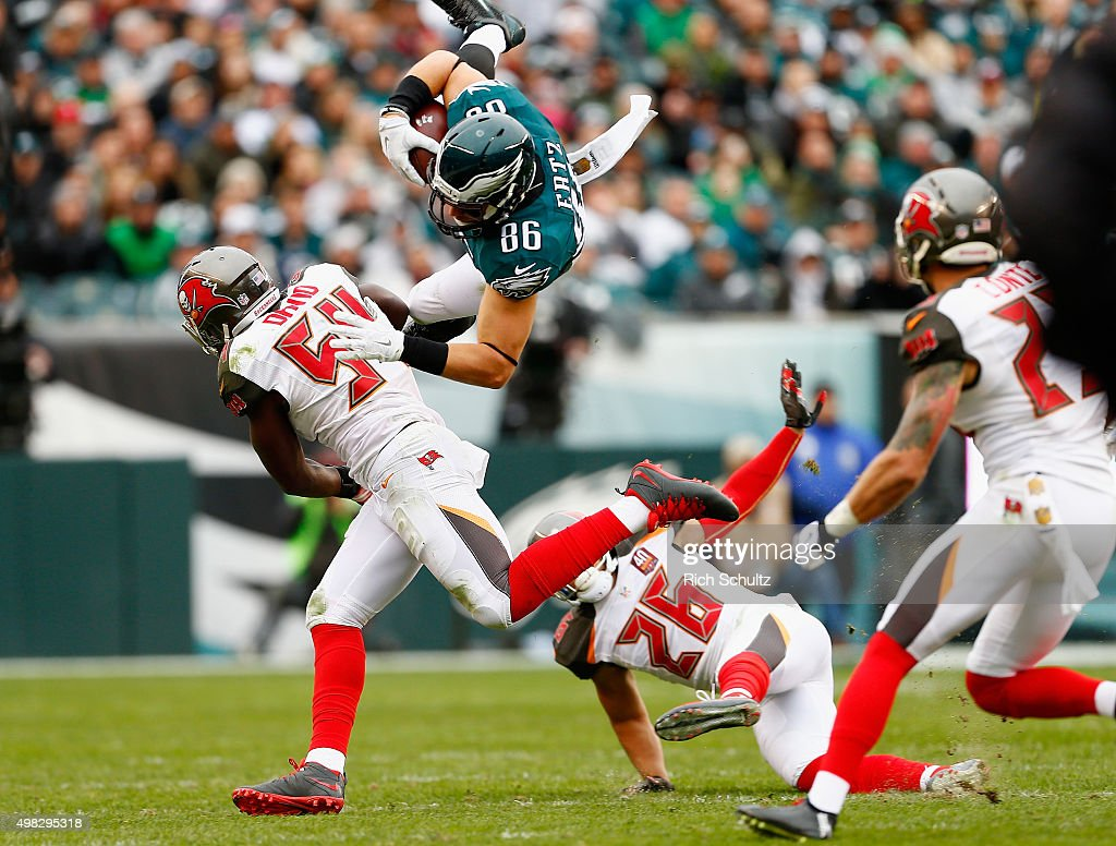 Zach Ertz #86 of the Philadelphia Eagles flies through the air as he makes a reception against Lavonte David #54 of the Tampa Bay Buccaneers in the second quarter at Lincoln Financial Field on November 22, 2015 in Philadelphia, Pennsylvania.