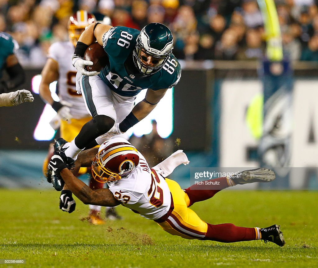 <a gi-track='captionPersonalityLinkClicked' href=/galleries/search?phrase=Zach+Ertz&family=editorial&specificpeople=7172878 ng-click='$event.stopPropagation()'>Zach Ertz</a> #86 of the Philadelphia Eagles jumps over <a gi-track='captionPersonalityLinkClicked' href=/galleries/search?phrase=DeAngelo+Hall&family=editorial&specificpeople=209065 ng-click='$event.stopPropagation()'>DeAngelo Hall</a> #23 of the Washington Redskins after making a catch for a first down in the second quarter of a football game at Lincoln Financial Field on December 26, 2015 in Philadelphia, Pennsylvania.