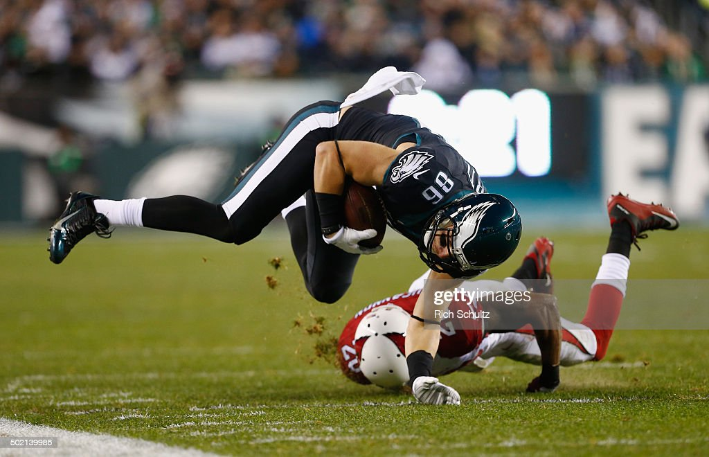 <a gi-track='captionPersonalityLinkClicked' href=/galleries/search?phrase=Zach+Ertz&family=editorial&specificpeople=7172878 ng-click='$event.stopPropagation()'>Zach Ertz</a> #86 of the Philadelphia Eagles makes a catch and is knocked out of bounds by <a gi-track='captionPersonalityLinkClicked' href=/galleries/search?phrase=Deone+Bucannon&family=editorial&specificpeople=8583776 ng-click='$event.stopPropagation()'>Deone Bucannon</a> #20 of the Arizona Cardinals in the second quarter at Lincoln Financial Field on December 20, 2015 in Philadelphia, Pennsylvania.