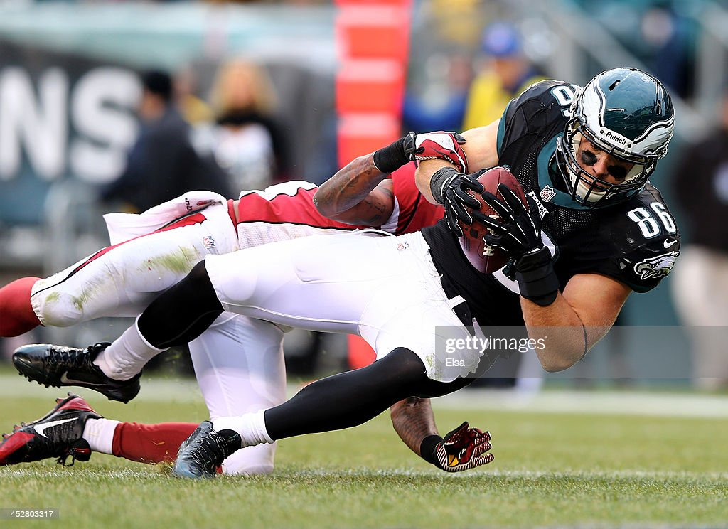 <a gi-track='captionPersonalityLinkClicked' href=/galleries/search?phrase=Zach+Ertz&family=editorial&specificpeople=7172878 ng-click='$event.stopPropagation()'>Zach Ertz</a> #86 of the Philadelphia Eagles scores a touchdown as <a gi-track='captionPersonalityLinkClicked' href=/galleries/search?phrase=Rashard+Mendenhall&family=editorial&specificpeople=2167325 ng-click='$event.stopPropagation()'>Rashard Mendenhall</a> #28 of the Arizona Cardinals defends on December 1, 2013 at Lincoln Financial Field in Philadelphia, Pennslyvania.The Philadelphia Eagles defeated the Arizona Cardinals 24-21.