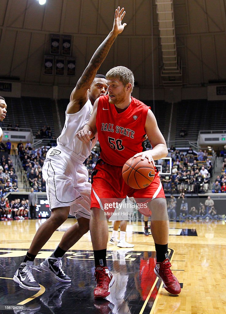 Zach Fields #50 of the Ball State Cardinals dribbles against Jacob Lawson #34 of the Purdue Boilermakers at Mackey Arena on December 18, 2012 in West Lafayette, Indiana.