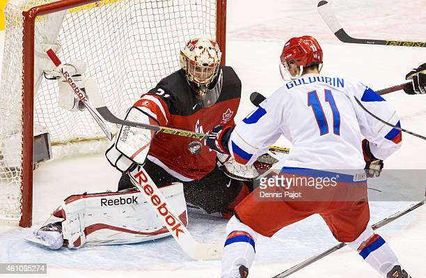 Zach Fucale of Canada makes a huge save against Nikolai Goldobin of Russia during the Gold medal game of the 2015 IIHF World Junior Championship on...