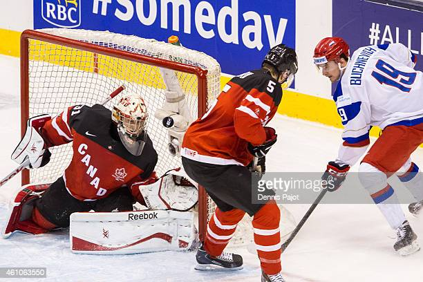 Zach Fucale of Canada makes a huge save against Pavel Buchnevich of Russia during the Gold medal game of the 2015 IIHF World Junior Championship on...