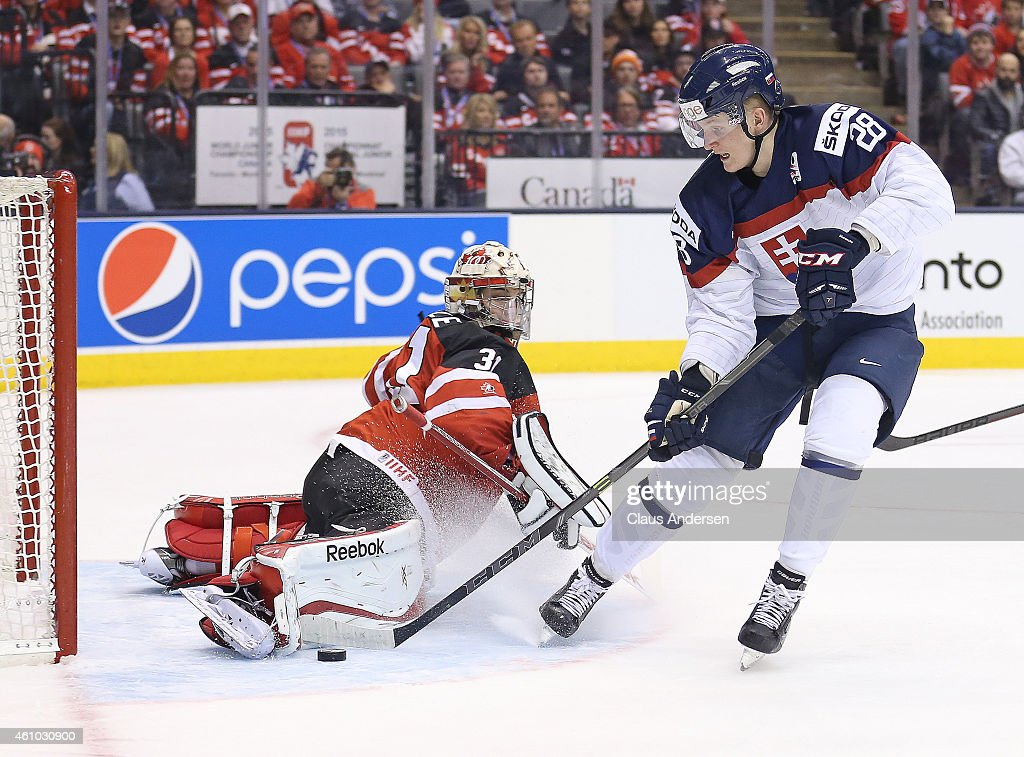 Zach Fucale #31 of Team Canada makes a big save against Pavol Skalicky #28 of Team Slovakia during a semi-final game in the 2015 IIHF World Junior Hockey Championship at the Air Canada Centre on January 4, 2015 in Toronto, Ontario, Canada.